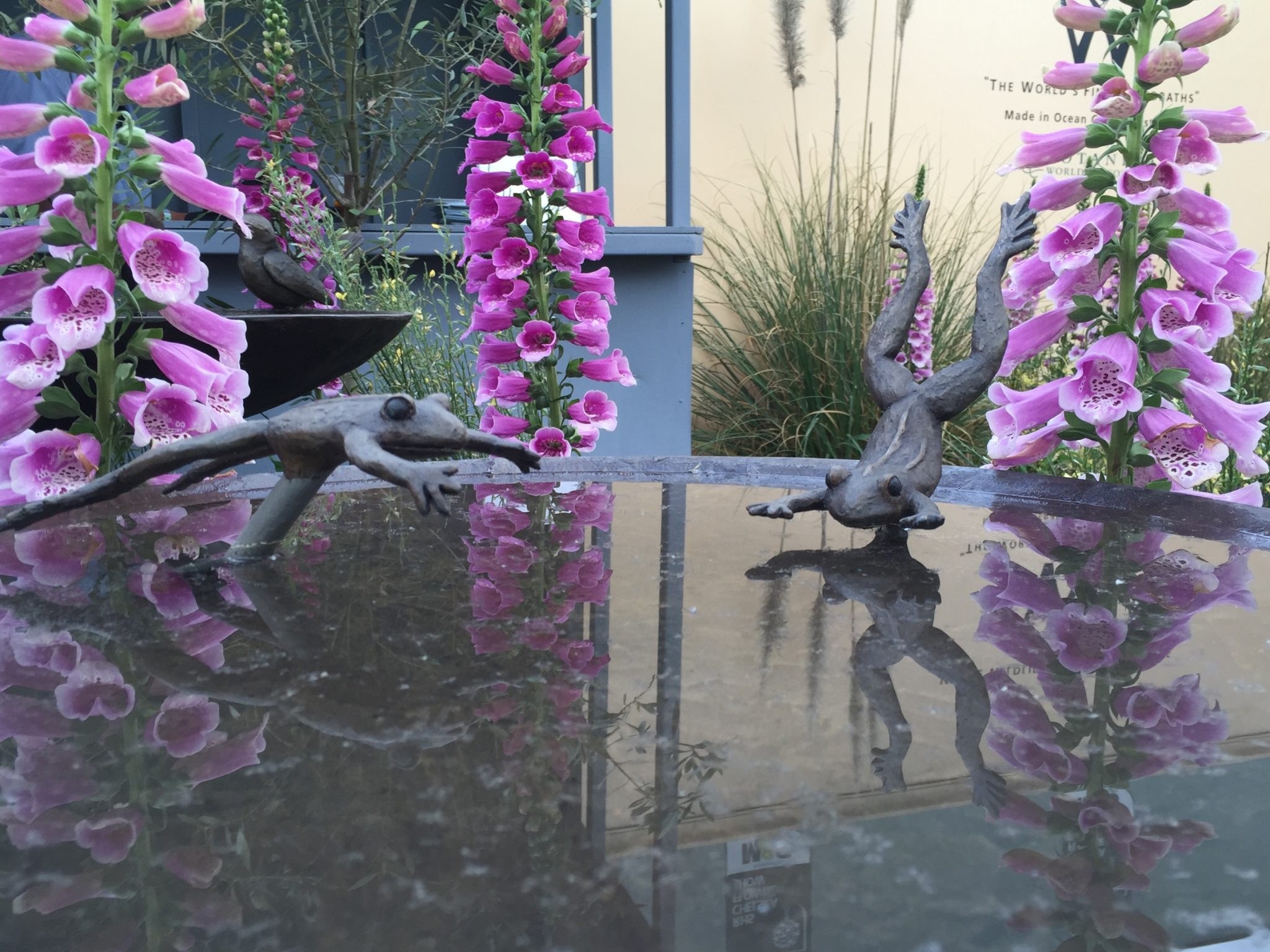 Frogs leaping into Birdbath Sculpture Chelsea Flower Show